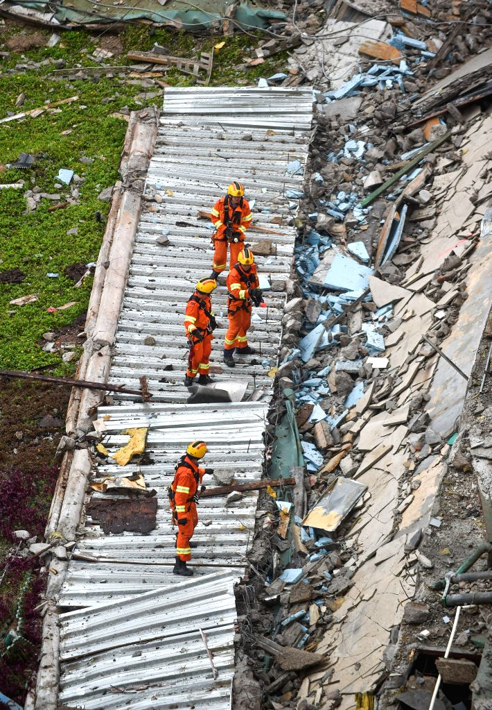 HONG KONG, May 20, 2016 - Rescuers work at a rooftop collapse site in the City University of Hong Kong in south China's Hong Kong, May 20, 2016. Currently three people have been confirmed injured ...