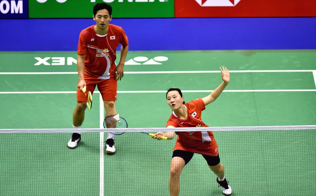 HONG KONG, Nov. 12, 2019 - Choi Solgyu/Shin Seung Chan (R) of South Korea compete during the mixed doubles first round qualification match against Tam Chun Hei/Yeung Nga Ting of China's Hong Kong at ...