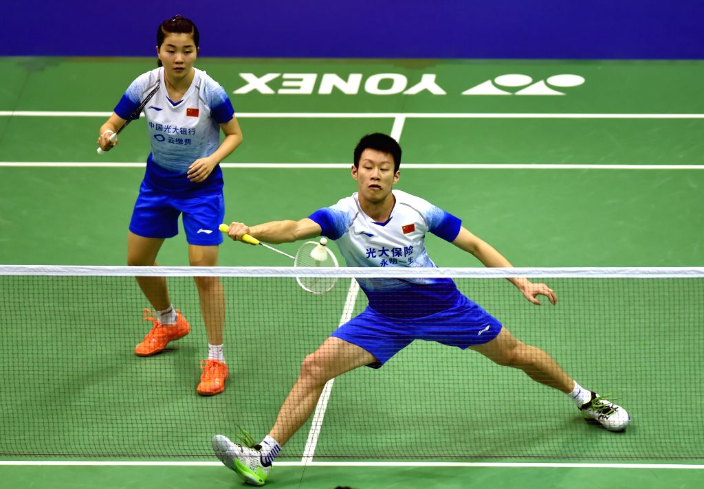 HONG KONG, Nov. 12, 2019 - Ren Xiangyu (R)/Zhou Chaomin of China compete during the mixed doubles first round qualification match against Lu Ching Yao/Lee Chia Hsin of Chinese Taipei at the 2019 Hong ...