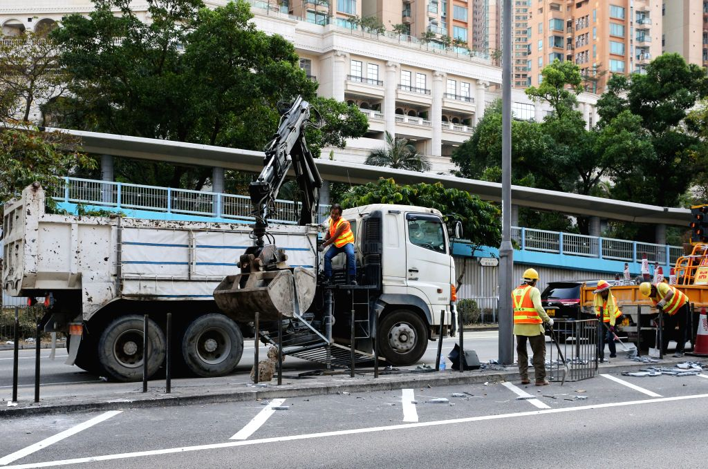 HONG KONG, Nov. 12, 2019 - Staff workers clear the road in Mong Kok, south China's Hong Kong, Nov. 12, 2019. The radicals' disruptive and violent acts raged on in different parts of Hong Kong on ...