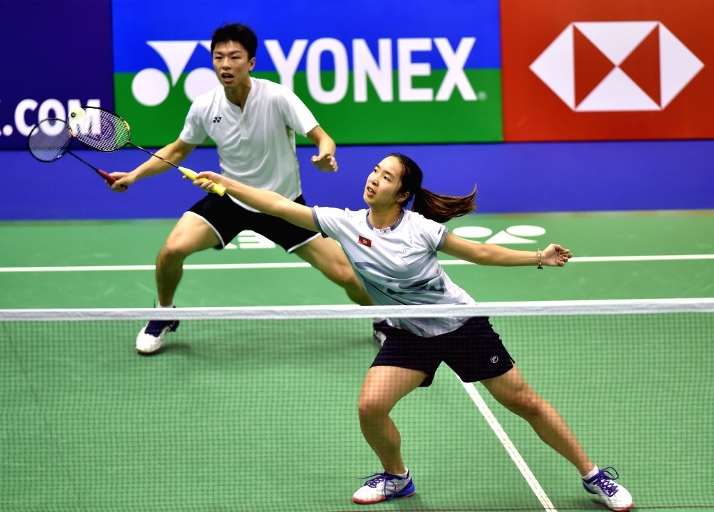 HONG KONG, Nov. 12, 2019 - Tam Chun Hei/Yeung Nga Ting (front) of China's Hong Kong compete during the mixed doubles first round qualification match against Choi Solgyu/Shin Seung Chan of South Korea ...