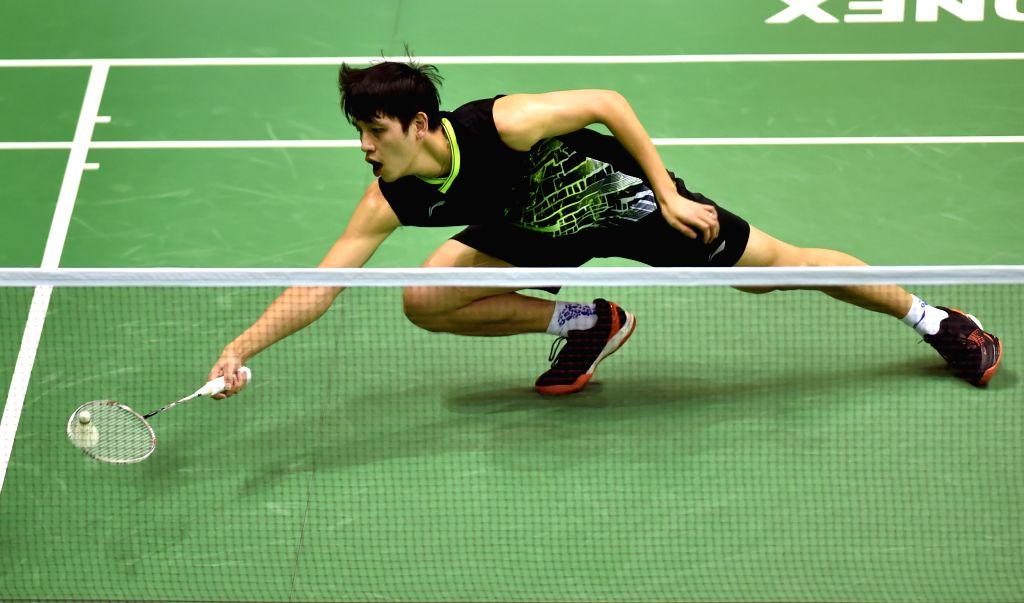 HONG KONG, Nov. 12, 2019 - Wong Wing Ki Vincent of China's Hong Kong returns the shuttle during the men's singles first round qualification match against his teammate Chan Yin Chak at the 2019 Hong ...