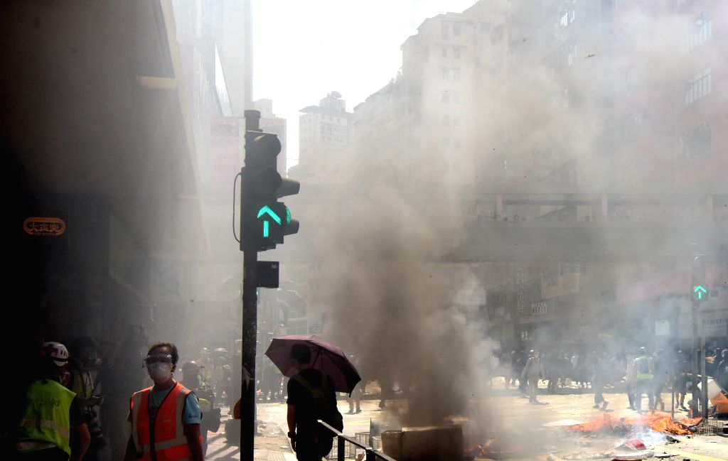 HONG KONG, Nov. 14, 2019 - Rioters set fire on a street in Sai Wan Ho in Hong Kong, south China, Nov. 11, 2019. It has been more than five months since the proposed ordinance amendments concerning ...