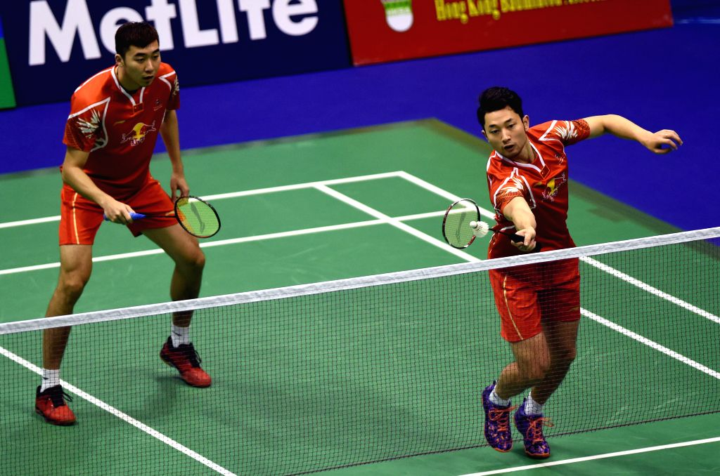 HONG KONG, Nov. 25, 2016 - Chai Biao (R) and Hong Wei of China compete during the quarterfinal of men's doubles match against Law Cheuk Him and Lee Chun Hei Reginald of Hong Kong of China at the 2016 ...