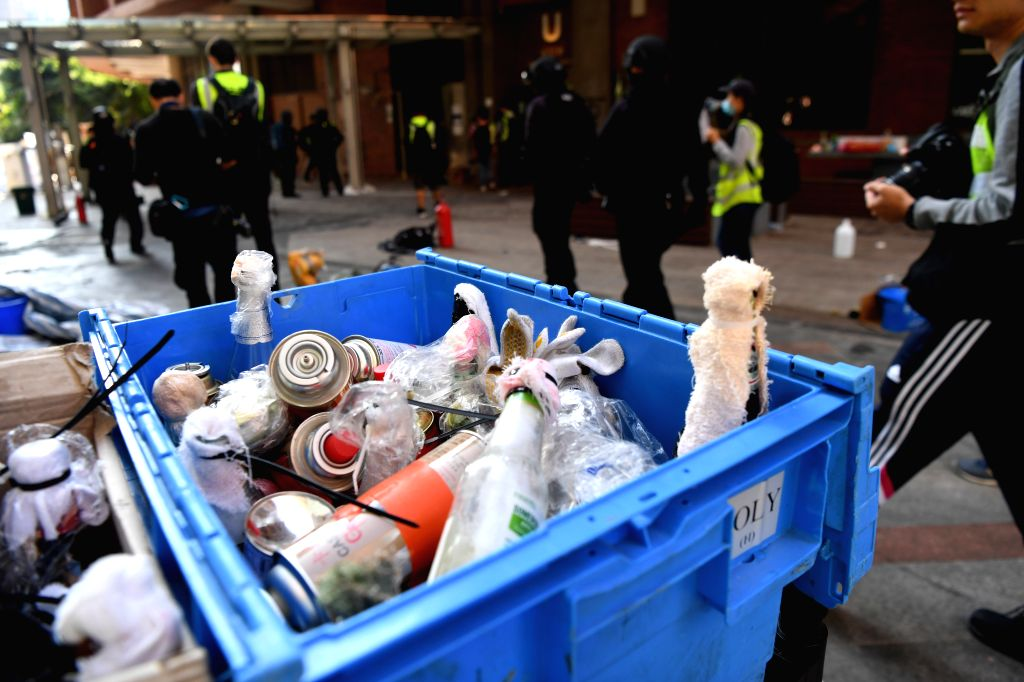 HONG KONG, Nov. 29, 2019 (Xinhua) -- Photo taken on Nov. 28, 2019 shows the petrol bombs and other dangerous items seized by the Hong Kong police on the campus of the Hong Kong Polytechnic University (PolyU) in Hong Kong, south China. The Hong Kong p
