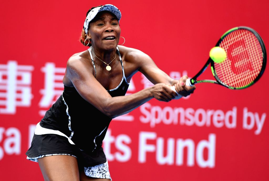 HONG KONG, Oct. 10, 2016 - Venus Williams of the United States hits a return to Risa Ozaki of Japan during the women's singles first round match at the Shanghai Masters tennis tournament in Hong ...