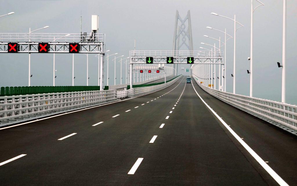 HONG KONG, Oct. 24, 2018 - Cars run on the Hong Kong-Zhuhai-Macao Bridge, Oct. 24, 2018. The Hong Kong-Zhuhai-Macao bridge, the world's longest cross-sea bridge, opened to public traffic at 9 a.m. ...