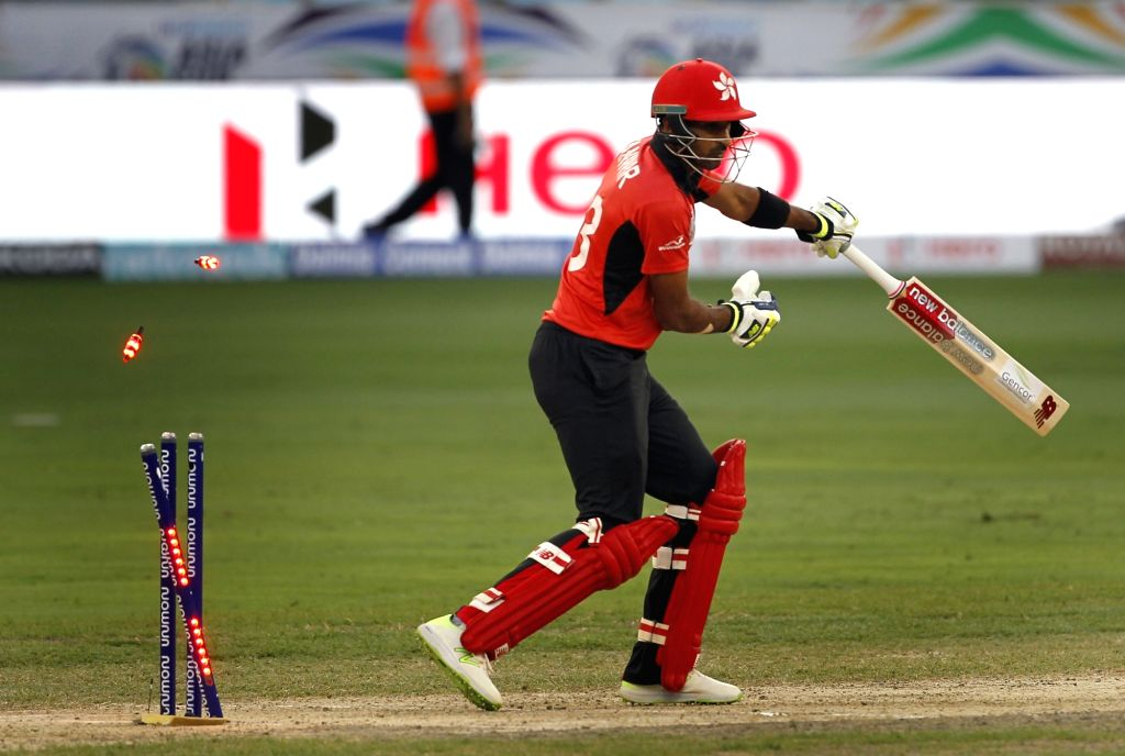 Hong Kong's Tanwir Afzal gets dismissed during the second match (Group A) of Asia Cup 2018 between Hong Kong and Pakistan at Dubai International Cricket Stadium on Sept 16, 2018.