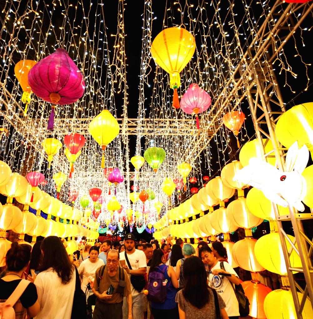 HONG KONG, Sept. 13, 2019 - People view lanterns at a lantern fair celebrating the Mid-Autumn Festival at Victoria Park in Hong Kong, south China, Sept. 13, 2019.