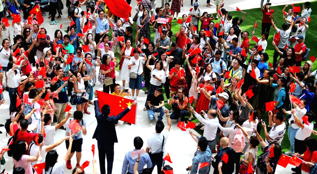 HONG KONG, Sept. 13, 2019 (Xinhua) -- People participate in a flash mob at Olympian City in Hong Kong, south China, Sept. 13, 2019. People chorused the Chinese national anthem during a flash mob in Hong Kong to celebrate the Mid-Autumn Festival on Fr