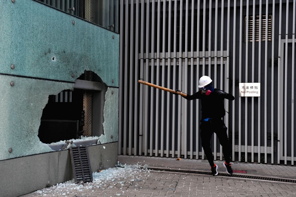 HONG KONG, Sept. 15, 2019 - A rioter destroys the elevator of the Hong Kong Special Administrative Region (HKSAR) government offices in Hong Kong, south China, Sept. 15, 2019. Rioters set fires in ...