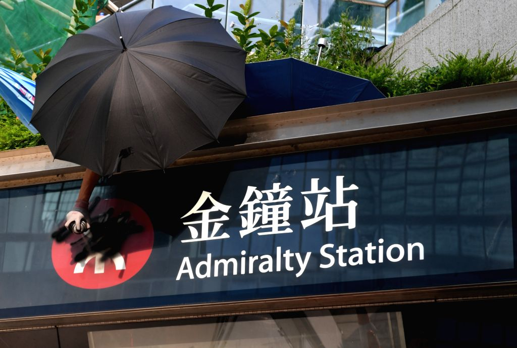 HONG KONG, Sept. 15, 2019 - A rioter vandalizes the mass transit railway (MTR) Admiralty station in Hong Kong, south China, Sept. 15, 2019. Rioters set fires in Central and Admiralty areas, threw ...