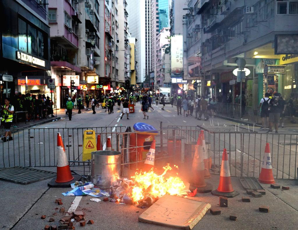 HONG KONG, Sept. 15, 2019 - Rioters set fires and obstruct road traffic at Queen's Road East in Hong Kong, south China, Sept. 15, 2019. Rioters set fires in Central and Admiralty areas, threw petrol ...