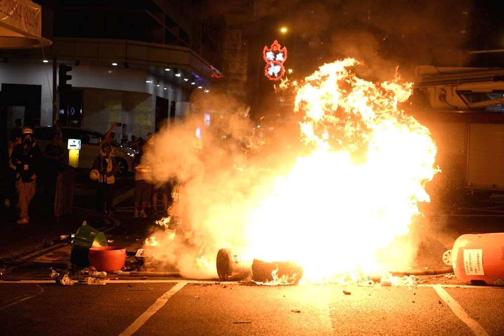 HONG KONG, Sept. 15, 2019 - Rioters set fires on Hennessy Road in Hong Kong, south China, Sept. 15, 2019. Rioters set fires in Central and Admiralty areas, threw petrol bombs at the Hong Kong Special ...