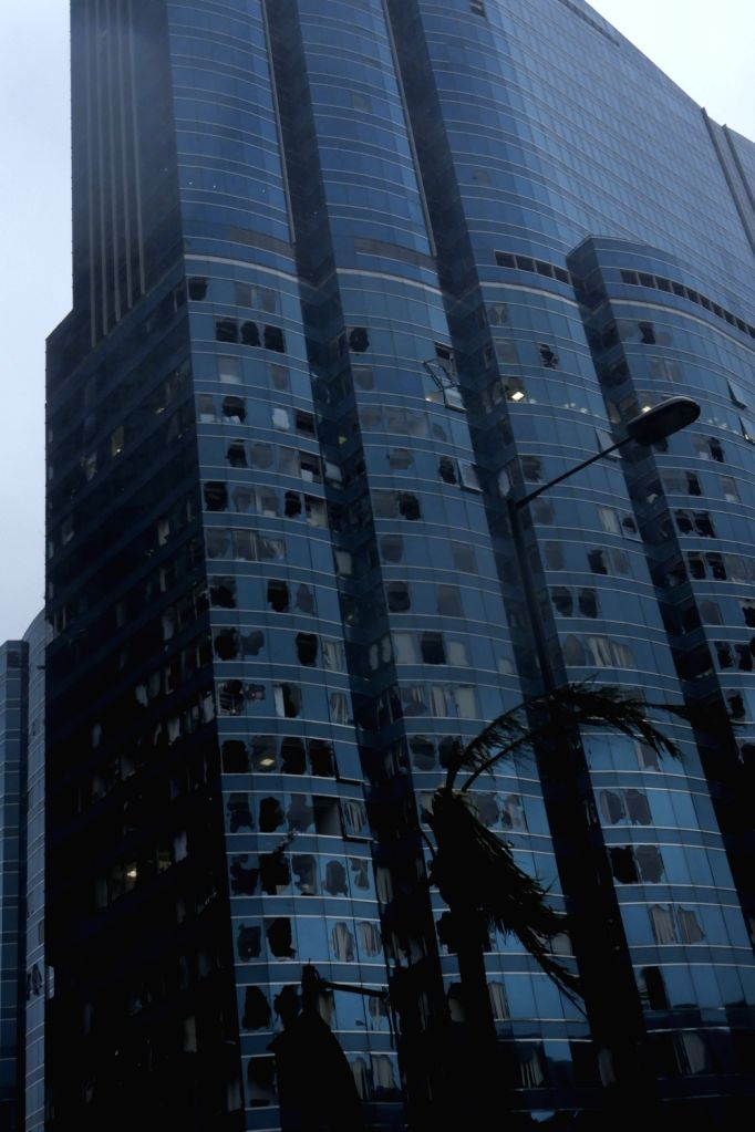 HONG KONG, Sept. 16, 2018 - Photo taken on Sept. 16, 2018 shows damaged windows of a building in Hong Kong, south China. Hurricane Signal No. 10, the top level warning, was issued by the Hong Kong ...