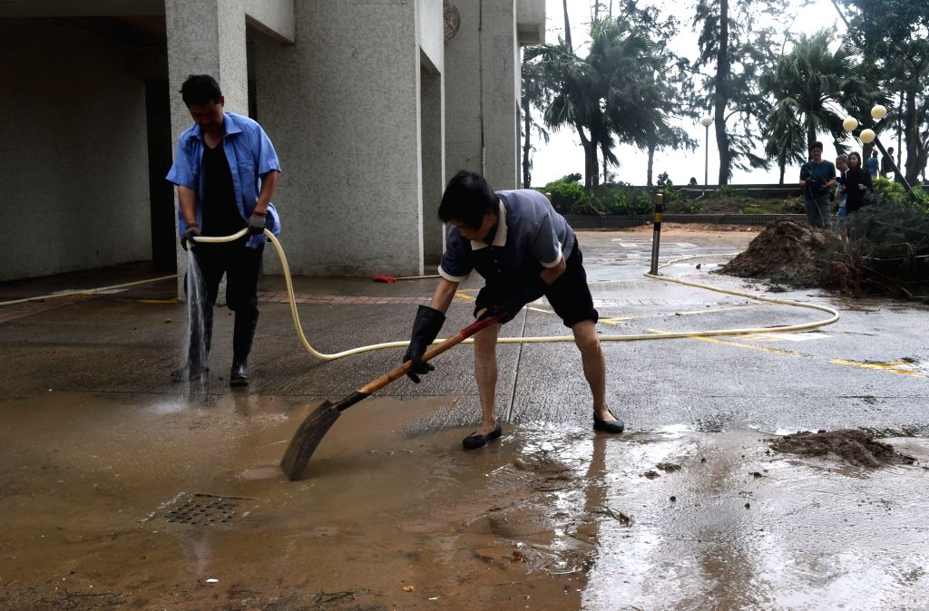 HONG KONG, Sept. 17, 2018 - Workers clean up mud left by Super Typhoon Mangkhut in Wan Chai of south China's Hong Kong, Sept. 17, 2018. The Hong Kong government is working to deal with the aftermath ...