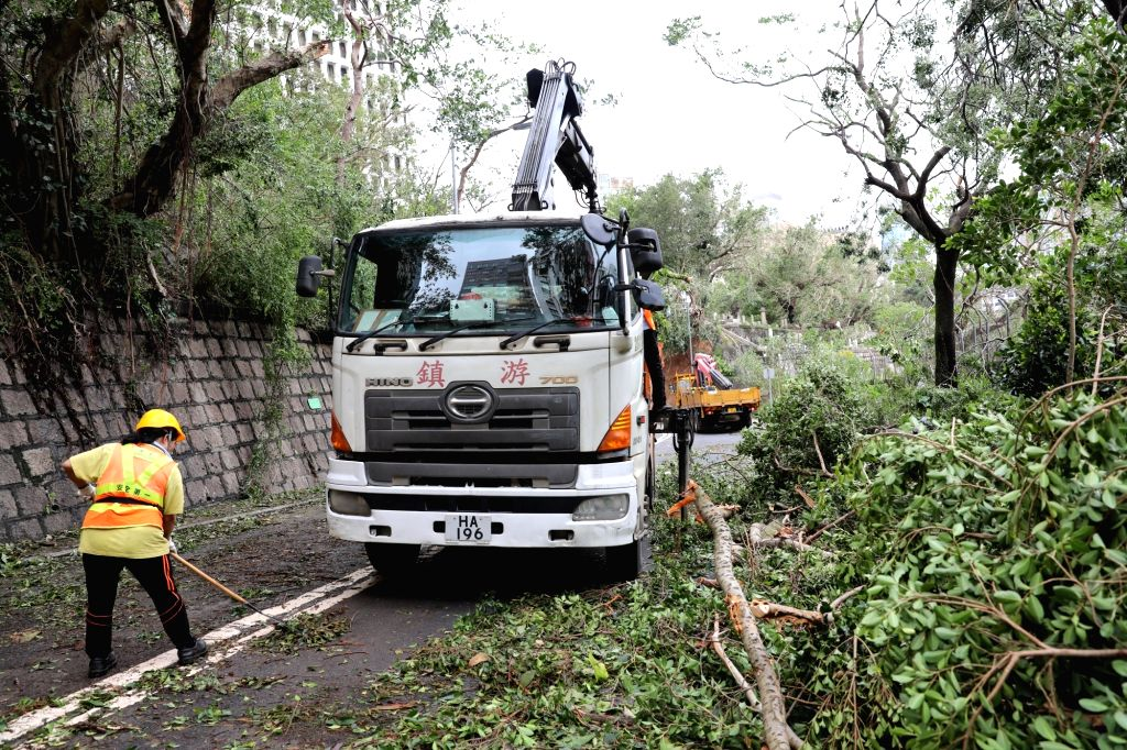 HONG KONG, Sept. 17, 2018 - Workers remove trees blown down by Super Typhoon Mangkhut in Wan Chai of south China's Hong Kong, Sept. 17, 2018. The Hong Kong government is working to deal with the ...