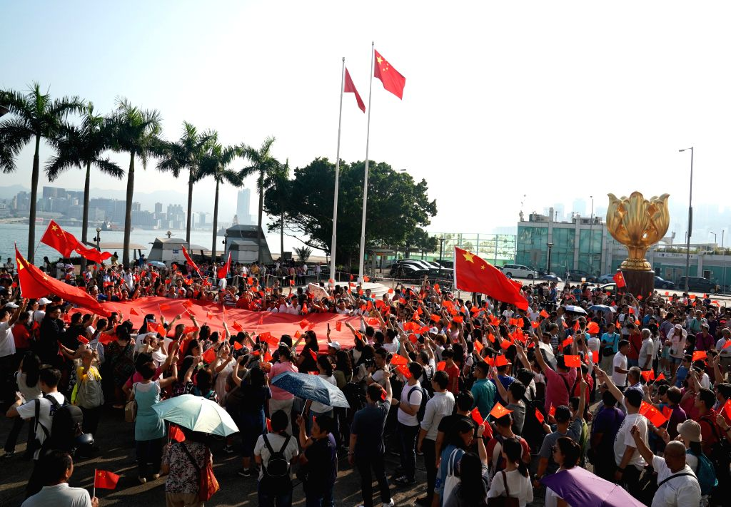 HONG KONG, Sept. 8, 2019 (Xinhua) -- People attend a national flag raising ceremony at the Golden Bauhinia Square in Hong Kong, south China, Sept. 8, 2019. (Xinhua/Li Gang/IANS)