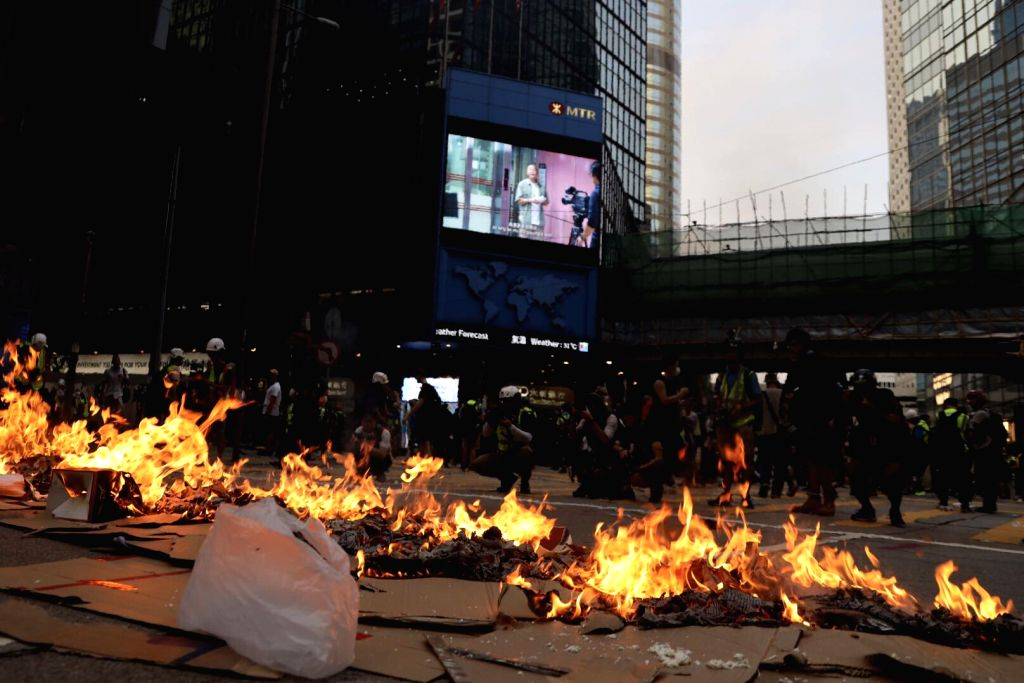 HONG KONG, Sept. 8, 2019 (Xinhua) -- Photo taken on Sept. 8, 2019 shows the site of a fire in Hong Kong, south China. Some radical demonstrators set fires on roads and at least one exit of the Mass Transit Railway (MTR) in the central areas of Hong K