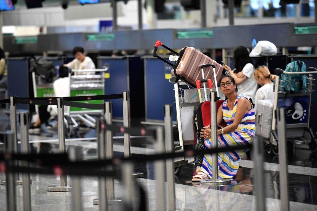 Hong Konng,Stranded passengers are seen at Hong Kong International Airport in Hong Kong, south China, Aug. 12, 2019. All flights in and out of China's Hong Kong Special Administrative Region were ...