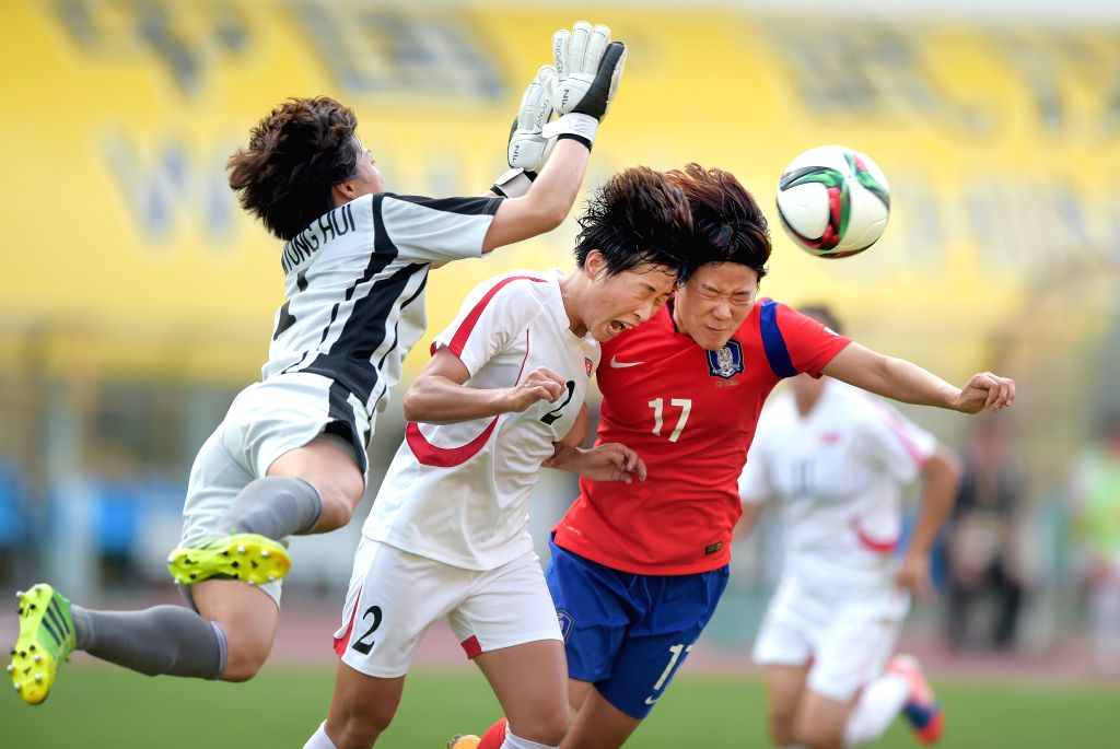 Hong Myong Hui(1st L) of the Democratic People's Republic of Korea (DPRK) competes during the match against South Korea at the 2015 EAFF(East Asian Football ...