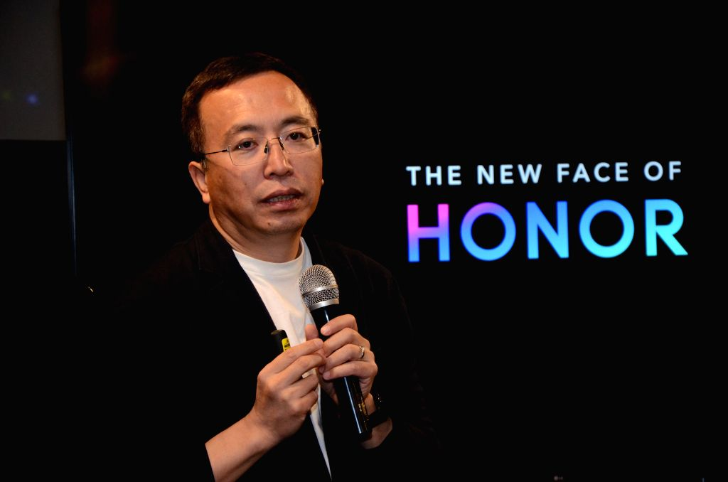 Honor Global President George Zhao addresses during a press conference in New Delhi on April 11, 2019.