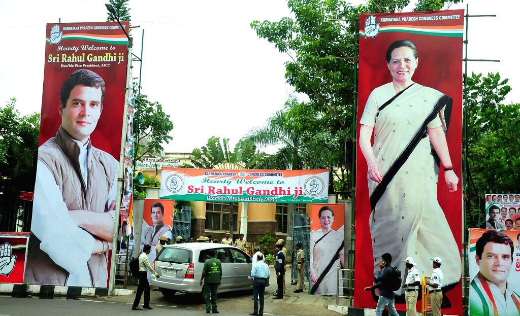Hording of Congress President Sonia Gandhi and Vice President Rahul Gandhi installed outside Congress office during Congress Committee meeting in Bengaluru on June 12, 2017. - Sonia Gandhi and Rahul Gandhi