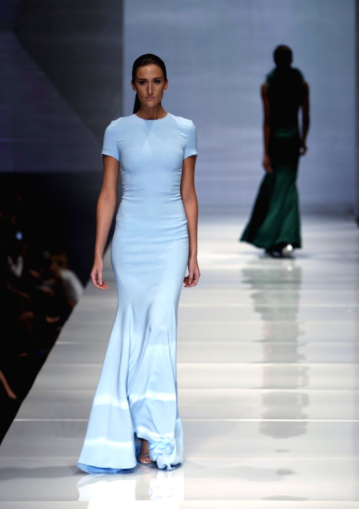 A model presents a creation of Rolando Santana during the Fashion Houston show in Houston, the United States, Nov. 20, 2014.