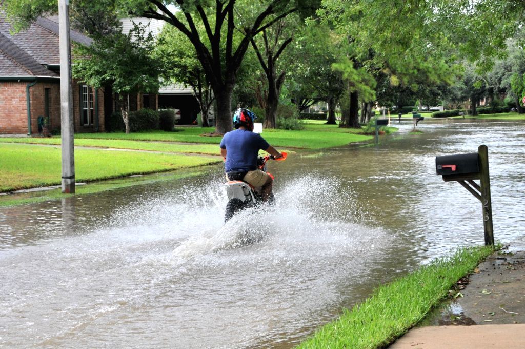 HOUSTON, Aug. 30, 2017 (Xinhua) -- A motorist drives on a waterlogged street in southwest Houston, the United States, on Aug. 29, 2017. Tropical storm Harvey has broken the record of rainfall from a cyclonic storm in the U.S. mainland, with 132 centi