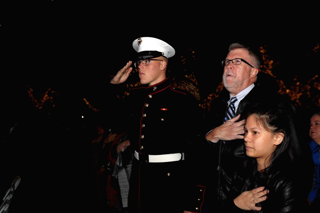HOUSTON, Dec. 4, 2018 - A soldier and his family attend a ceremony honoring the life of former U.S. President George H.W. Bush, who passed away on Nov. 30 at the age of 94, in Houston, Texas, the ...