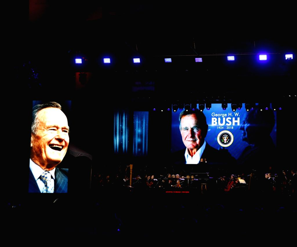 HOUSTON, Dec. 4, 2018 - People gather at Houston's City Hall to honor the life of former U.S. President George H.W. Bush, who passed away on Nov. 30 at the age of 94, in Houston, Texas, the United ...