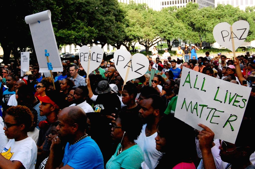 "HOUSTON, July 11, 2016 - People attend a rally at the City Hall in Houston, the United States, July 10, 2016. Hundreds of people participated in a peaceful march called ""A walk in Prayer to End ..."