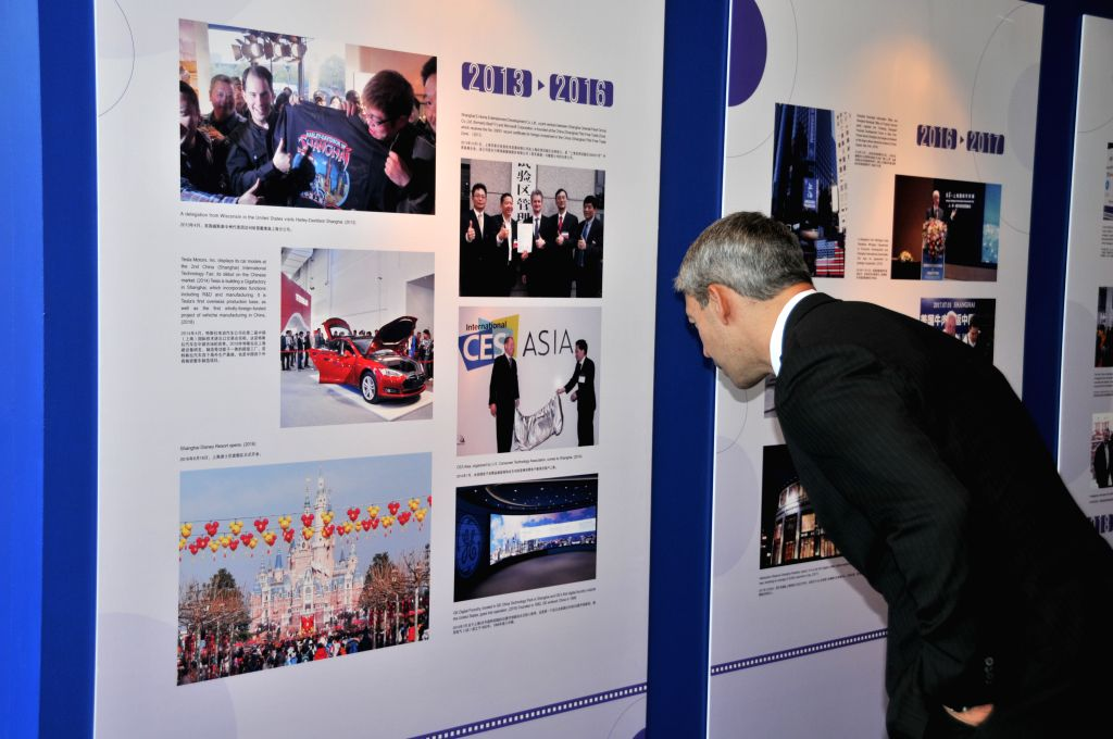 "HOUSTON, July 17, 2019 - Ron Nirenberg, chair of Sister Cities International (SCI), views photos during a photo exhibition with the theme of ""Trans-Pacific Exchange and CooperationShanghai ..."