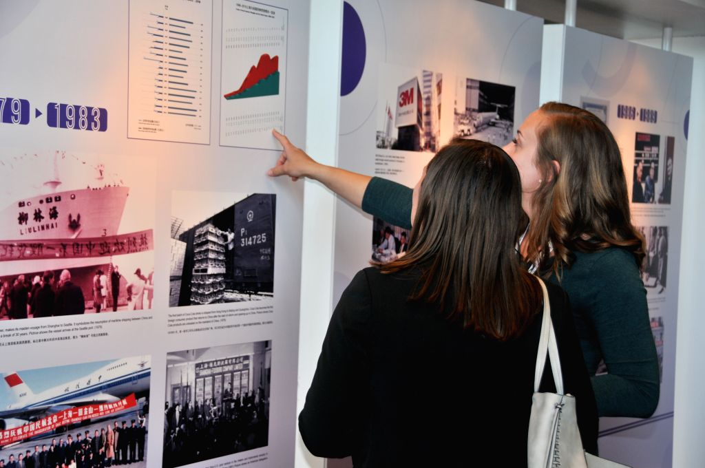 "HOUSTON, July 17, 2019 - Visitors view photos during a photo exhibition with the theme of ""Trans-Pacific Exchange and CooperationShanghai Commemorates the 40th Anniversary of China-U.S. ..."