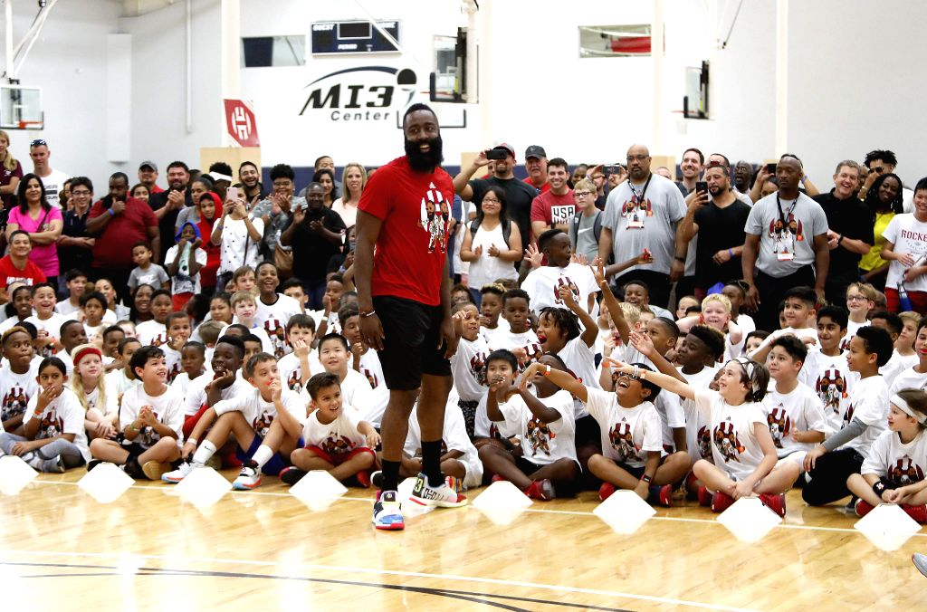 HOUSTON, July 21, 2019 - NBA Houston Rockets player James Harden plays with kids during the James Harden Basketball Camp in Houston, the United States, July 20, 2019,