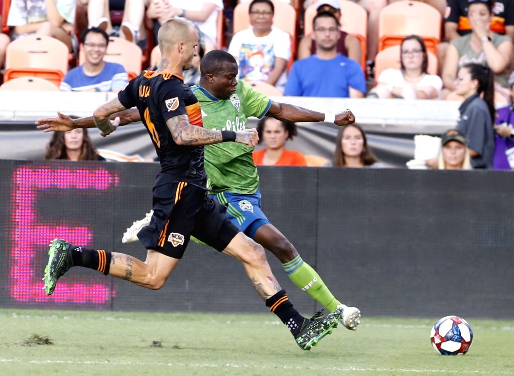 HOUSTON, July 28, 2019 - Dynamo's Kiki Struna (L) vies with Sounders' Nouhou Tolo during the 2019 Major League Soccer (MLS) match between Houston Dynamo and Seattle Sounders Football Club in Houston, ...