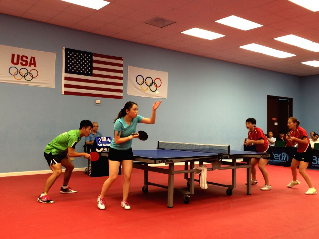 HOUSTON, July 30, 2016 - Members of team of table tennis of the United States react during a training game in Houston, U.S., July 29, 2016. The delegation of table tennis of U.S. took the last ...
