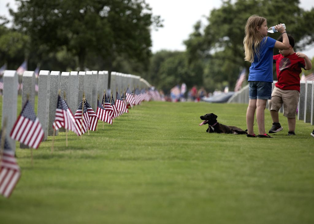 HOUSTON, May 27, 2019 - Children visit the Houston National Cemetery on Memorial Day in Houston, Texas, the United States, on May 27, 2019. Hundreds of people attended the annual Memorial Day ...