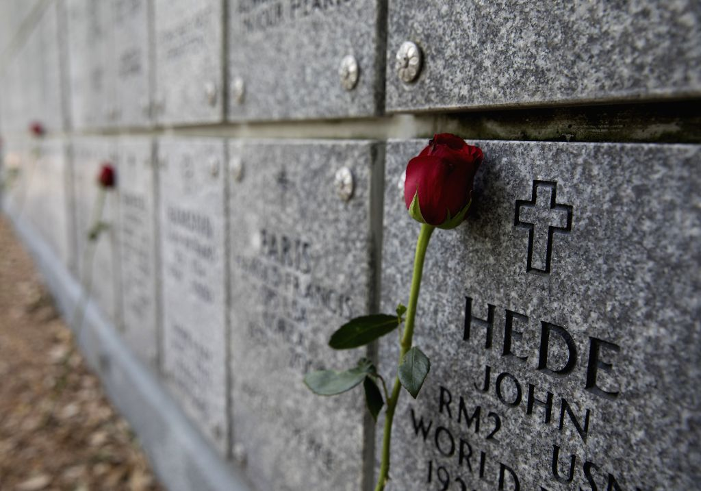 HOUSTON, May 27, 2019 - Fresh roses are seen in the Houston National Cemetery in Houston, Texas, the United States, on May 27, 2019. Hundreds of people attended the annual Memorial Day commemoration ...