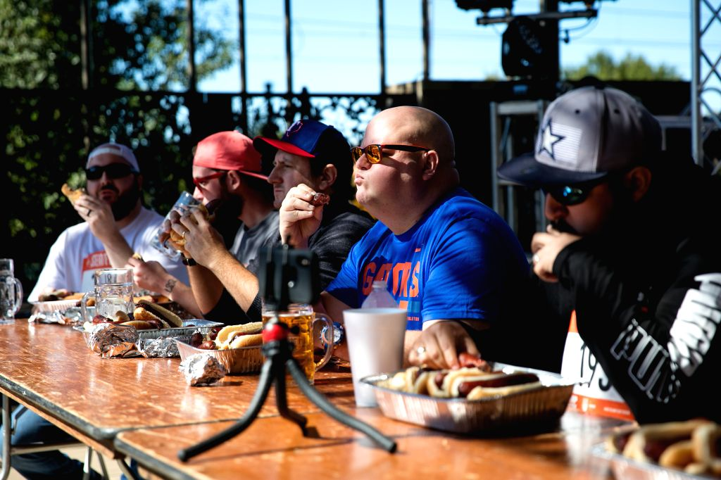 "HOUSTON, Oct. 27, 2019 - A group of contestants participate in ""Brat Eating"" contest at the Steinfest in Plano, Texas, the United States, on Oct. 26, 2019. Steinfest is an Oktoberfest-style ..."