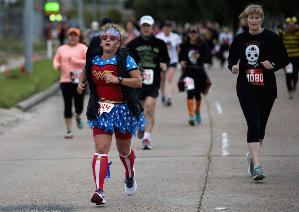 HOUSTON, Oct. 27, 2019 - People participate in a Halloween-themed run to celebrate the upcoming festival in Houston, Texas, the United States, on Oct. 26, 2019. Over 1,600 runners participated in the ...