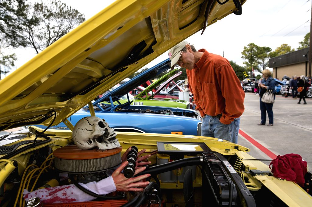 HOUSTON, Oct. 27, 2019 - People visit the 12th Annual Halloween Classic Car Show at National Museum of Funeral History in Houston, Texas, the United States, on Oct. 26, 2019. (Photo by Yi-Chin ...