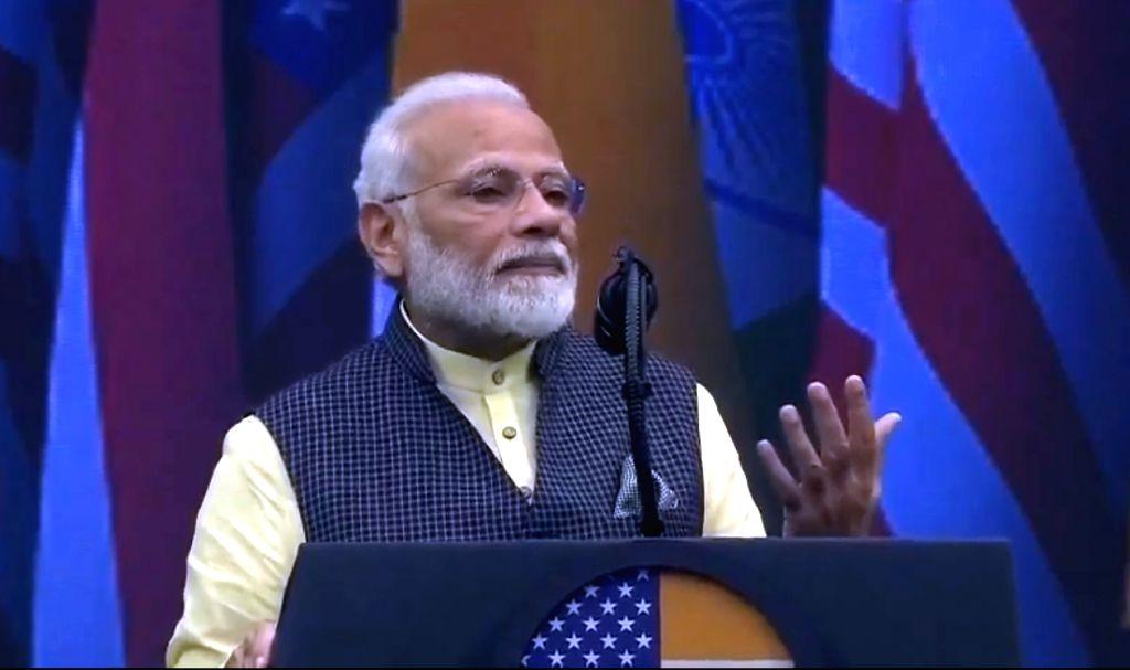 Houston: Prime Minister Narendra Modi addresses during the 'Howdy Modi' event at NRG Stadium in Houston, USA, on Sep 22, 2019. (Photo: IANS/BJP) - Narendra Modi