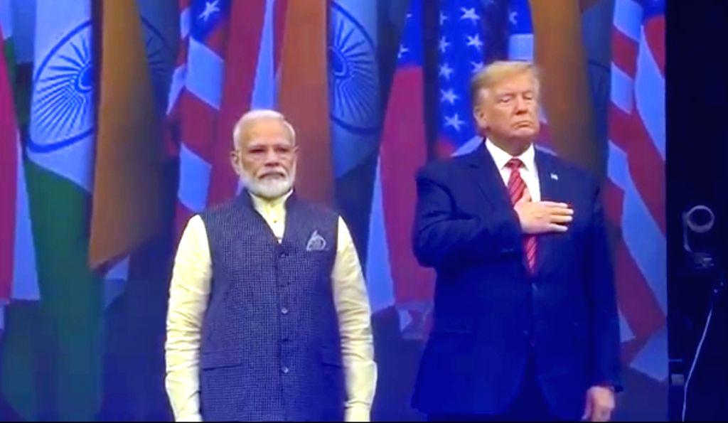 Houston: Prime Minister Narendra Modi and US President Donald Trump during the 'Howdy Modi' event at NRG Stadium in Houston, USA, on Sep 22, 2019. (Photo: IANS/BJP) - Narendra Modi