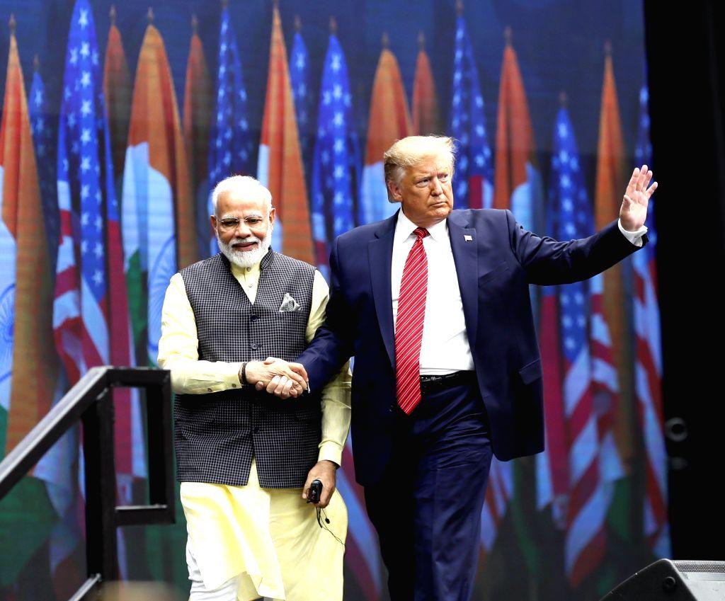 "HOUSTON, Sept. 23, 2019 - Indian Prime Minister Narendra Modi (L) and U.S. President Donald Trump attend the ""Howdy, Modi!"" rally in Houston, Texas, the United States on Sept. 22, 2019. ... - Narendra Modi"