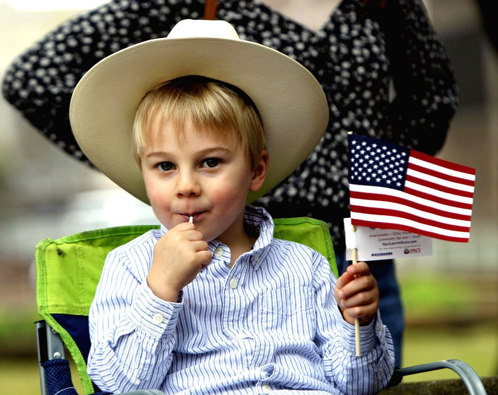 HOUSTON (U.S.), Feb. 23, 2019 A boy watches the annual Houston Rodeo parade in Houston, Texas, the United States, Feb. 23, 2019. More than 2,000 trail riders gathered in downtown Houston ...