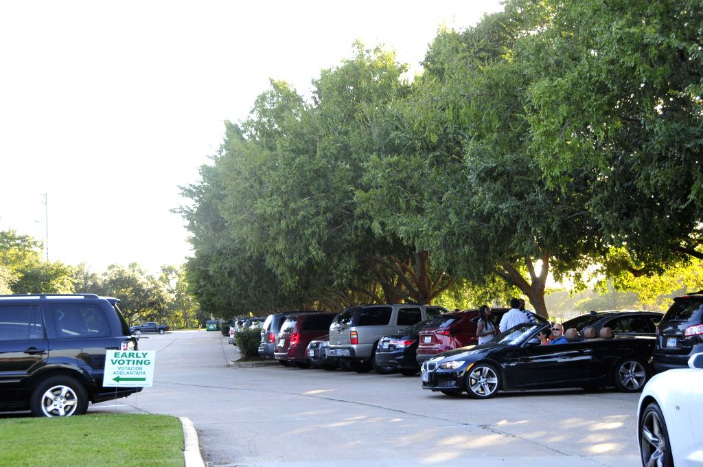 HOUSTON (U.S.), Oct. 29, 2016 Texan voters park their cars outside a polling place in Houston, Texas, the United States, on Oct. 28, 2016. Texas, where the early voting is available ...