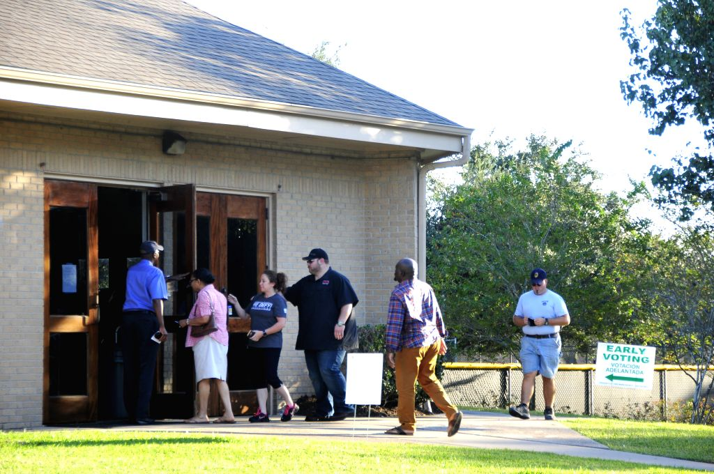 HOUSTON (U.S.), Oct. 29, 2016 Texan voters queue up for early voting at a polling place in Houston, Texas, the United States, on Oct. 28, 2016. Texas, where the early voting is available ...