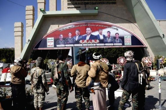 """Houthi fighters protest against the U.S. designation of the Houthi militia as """"a terrorist group"""" in Sanaa, Yemen, Jan. 11, 2021."""