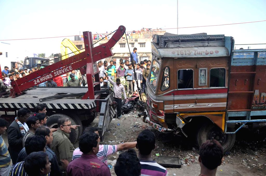 A crane removes the truck that crushed three women and a three-year-old child to death and injured two others on the Kona Expressway near state secretariat Nabanna, in Howrah, near Kolkata on